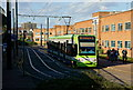 TQ3165 : Tram Leaving the Reeves Corner Tram Stop, Croydon by Peter Trimming