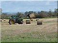 NY3863 : Stacking straw bales by Oliver Dixon