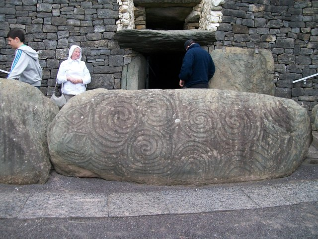 Intricately carved stones at the entrance to the Newgrange Tomb
