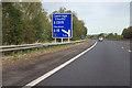 TL4452 : M11 - 1/2 mile sign, junction 11 by Robin Webster