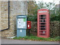 SY4892 : Walditch: postbox № DT6 16 and phone by Chris Downer