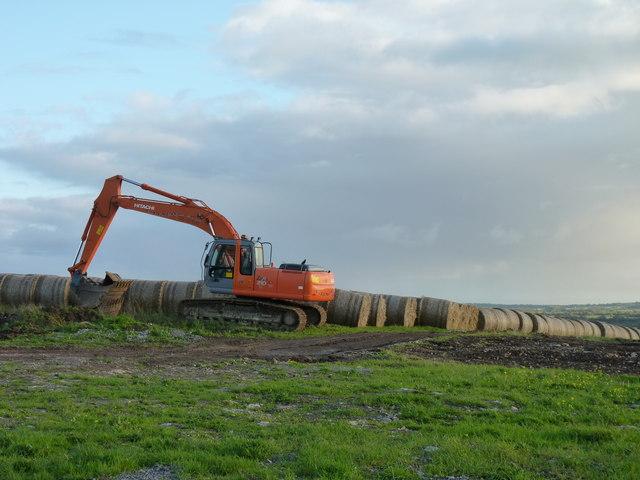 Digger and bales