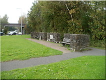 ST2995 : Two benches and three low stone walls opposite Forge Hammer roundabout, Cwmbran by Jaggery
