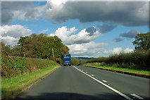 NZ5509 : A173 - following a blue coach by Robin Webster