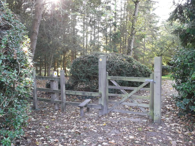 Gate and stile beside Alvescot village hall