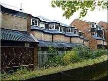 SK3536 : Vandalised flats near the city centre by Graham Hogg