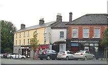 N5580 : Businesses in Oliver Plunkett's Street by Eric Jones