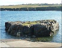 NB5363 : Rock by slipway, Port Nis by Rob Farrow