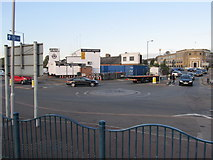 TQ1983 : Roundabout on service road, Stonebridge Park by Richard Rogerson