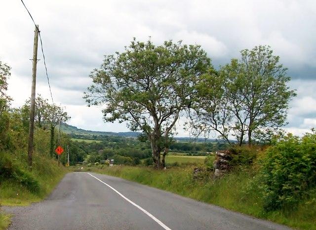 The L3042 descending towards the Knocknaveagh Cross Roads