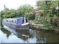 SK7080 : Narrowboat moored alongside a back garden by Christine Johnstone