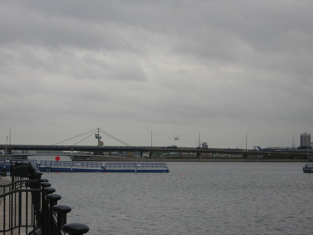 Royal Victoria Dock, with plane landing at London City Airport