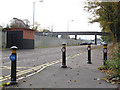 TQ3264 : Cycle bollards by Stephen Craven