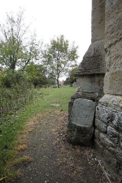 Headstone by the buttress