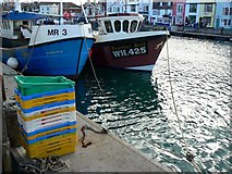 SY6778 : Fishing boats and fish boxes, Weymouth Harbour by Brian Robert Marshall