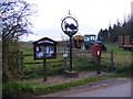 TM3684 : Notice Board Village Sign & White Horse Farm Postbox by Geographer