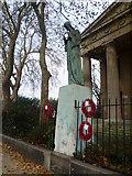 TQ3377 : War memorial in front of St George's Church, Wells Way by Marathon