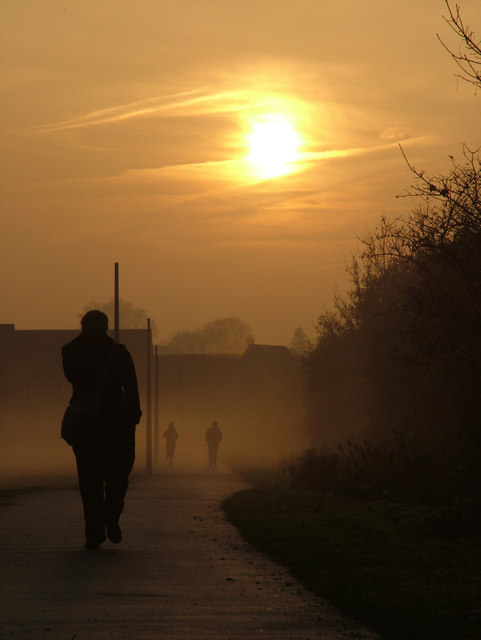 Two walkers and a jogger, in early morning mist