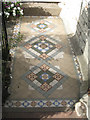 SX9372 : Patterned tiled path, Alexandra Terrace by Robin Stott