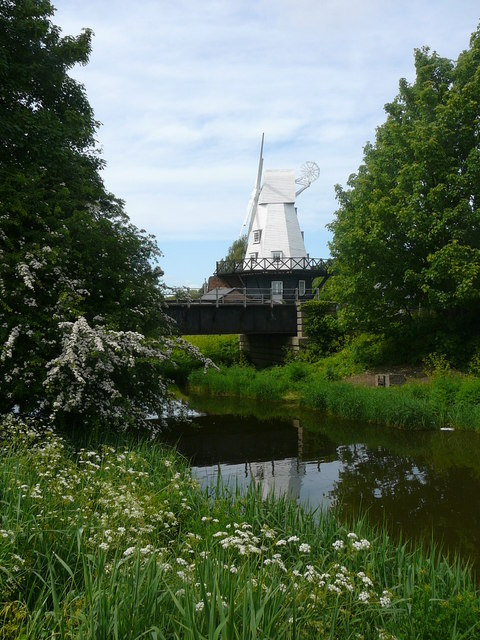 Railway bridge over River Tillingham in Rye and weatherboarded windmill