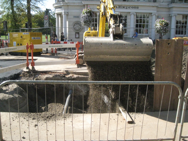 Backfilling a sewer trench in the Parade