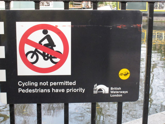 "Paddington Arm - contradictory ""Cycling not permitted"" sign"
