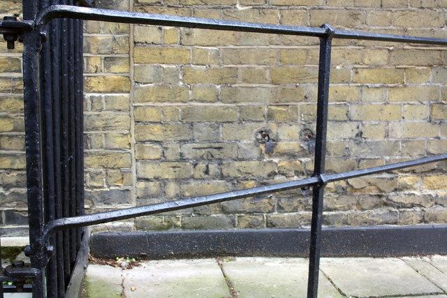 Benchmark on wall of #33 Sekforde Street