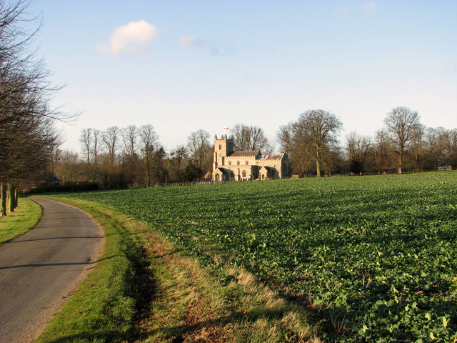 Rapeseed oil crop by St Mary's church, East Raynham