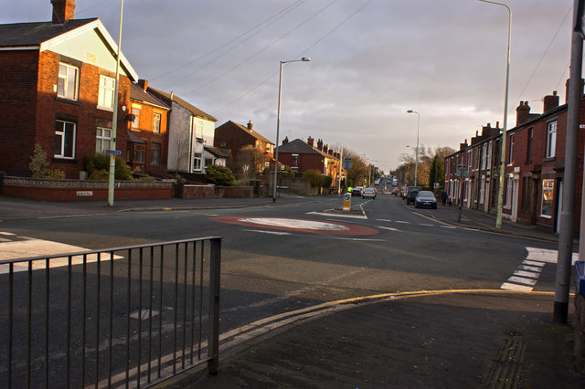 The mini roundabout on Chorley Road at the end of Rawlinson Lane