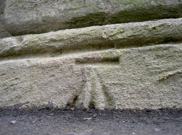Benchmark on the entrance pillar