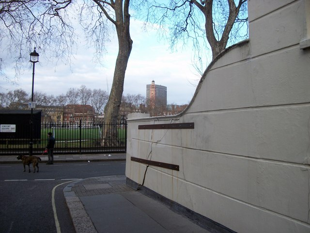 Repaired wall at junction of Vinvent Square and Street