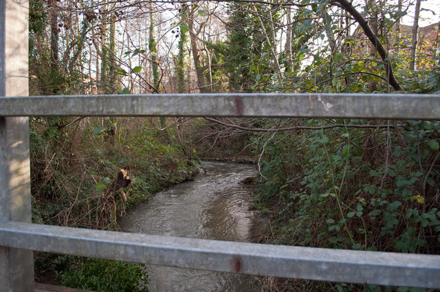 The view upstream on Coney Gut from a footbridge near Fairacre Avenue and Homebase