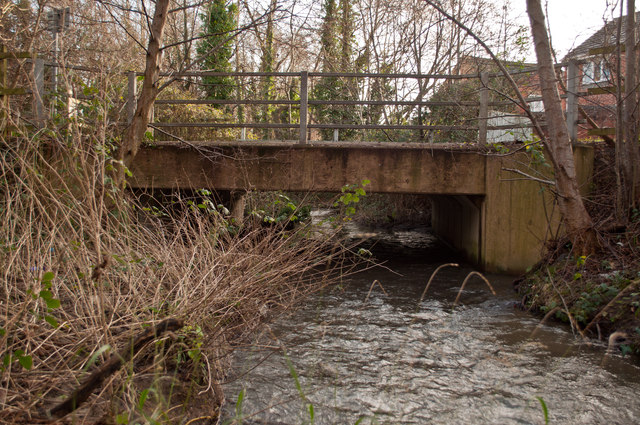 A view from downstream of a footbridge near Homebase and Fairacre Avenue crossing Coney Gut