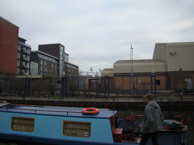 The Olympic Stadium peeking over the top of industrial units on the Hertford Union Canal