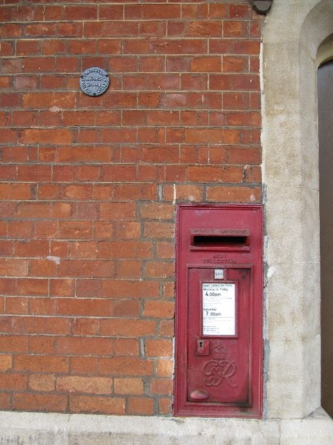 Postbox by the doorway