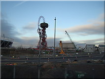 TQ3783 : View of the viewing tower and the Aquatics Centre from outside the Container Cafe by Robert Lamb