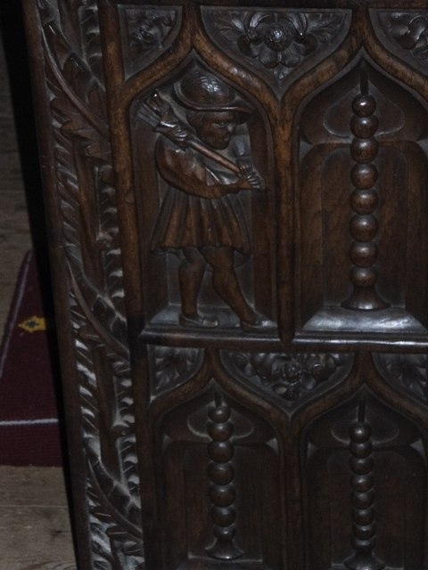 Bench end in Bickleigh Church showing wool worker