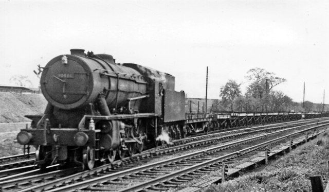 Down train of empty flat wagons for steel plates approaching Northallerton