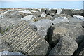 NZ7818 : Staithes eastern breakwater by Graham Horn