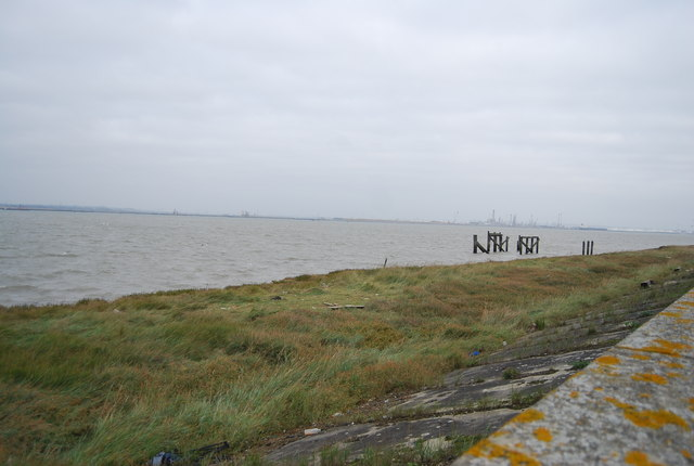 Marsh, estuary and ruined pier