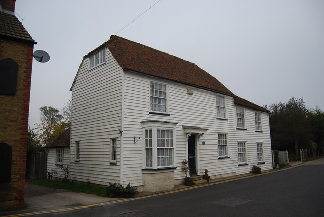 A pair of weatherboarded cottages.