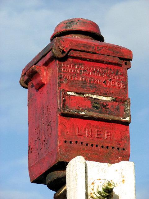 County School Station - old railway lamp at buffer stop