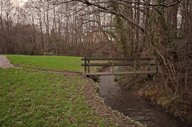 A footbridge on Coney Gut behind houses on Venlock Close