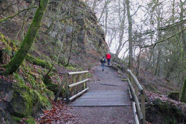 Path below rock outcrops, Calderglen Country Park