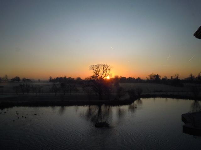Sunrise across lake at Ardencote Hotel