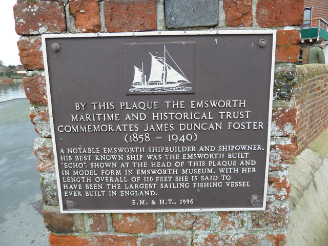 Plaque commemorating a local celebrity on a sailing club at Emsworth