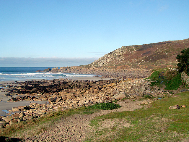 The South West Coastal Path drops down to the beach at Gwynver