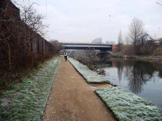 Cyclist on the riverside path