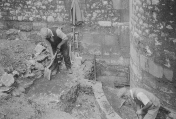 Workmen clearing the base of a tower at The Tower