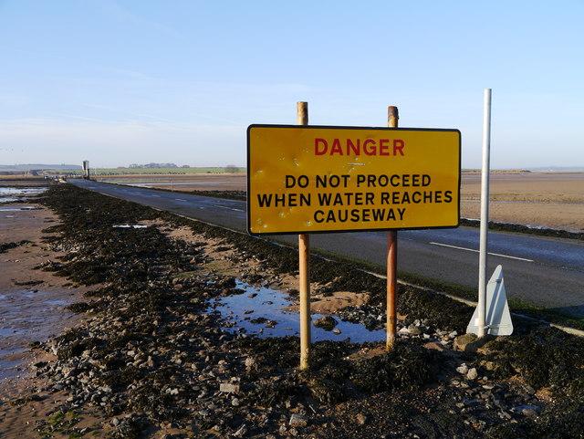 Warning Sign On Holy Island Causeway